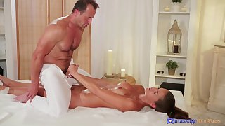 Fantastic hard sex between the older masseur and the young doll